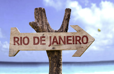 Rio de Janeiro sign with a beach on background