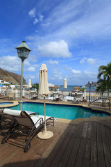 deck chairs near swimming pool