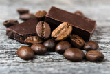 close up of coffee beans and  chocolate on gray background © sola_sola