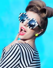 Young attractive  woman wearing stripy sunglasses