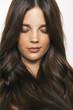 Caucasian brunette model with long wavy hair