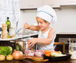 canvas print picture - Baby girl cooking with meat