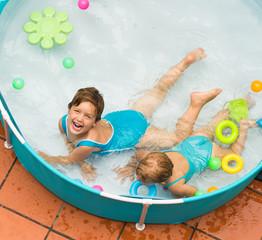 Children swimming in kid pool