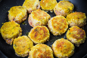 Set chops minced meat during frying
