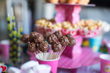 Chocolate cakepops on holiday dessert table at kid birthday