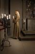 Nun praying in a medieval church