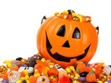 Halloween Jack o Lantern pail overflowing with candy