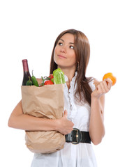 Young woman holding shopping bag full of vegetables