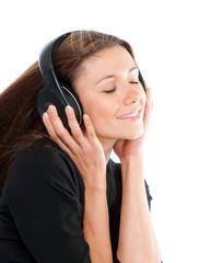 Happy woman listening and enjoy music in headphones smiling eyes
