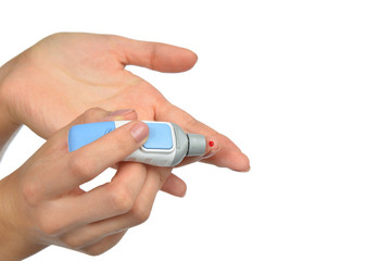 blood wound from diabetes patient finger to make glucose level b