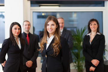 Business woman in front of a group of business people