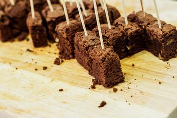 Chocolate brownies on wooden board