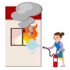 消火器で火を消す主婦