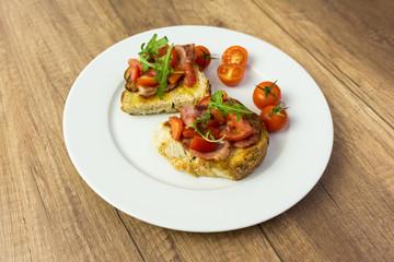 Plate With Italian Bruschetta On Table
