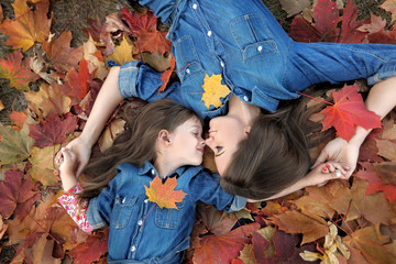 portrait of mother and daughter in the autumn
