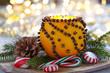 Zdjęcia na płótnie, fototapety, obrazy : Aromatic Christmas orange with candle