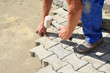 Worker laying interlocking pavers - 70593407