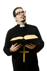 Priest reading the bible