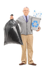 Senior holding a recycle bin and garbage bag
