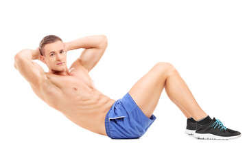 Handsome male athlete exercising on the floor
