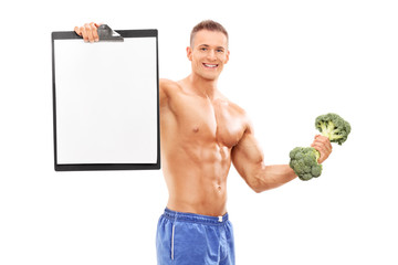 Athlete holding clipboard and a broccoli dumbbell
