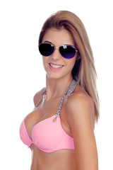 Attractive fashion woman with sunglasses and pink bikini