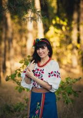 Portrait of beautiful ukrainian woman  posing outdoors