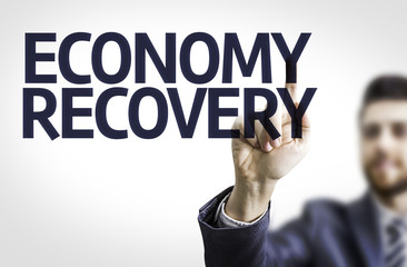 Business man pointing the text: Economy Recovery