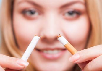 Addiction. Girl breaking cigarette. Quit smoking.