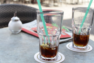 Two glasses of cola with straw