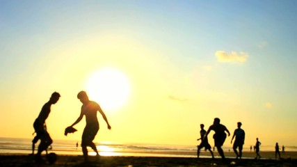 Summer Beach Football - Sand Soccer at Sunset