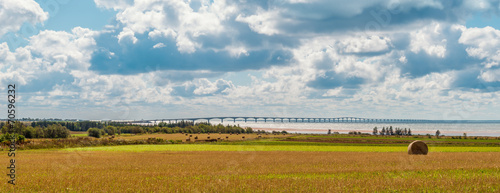 Staande foto Beijing Panorama of hay bales on a farm along the ocean with the Confede