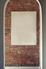 Blank canvas on rustic brick wall