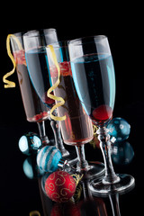 Blue and Pomegranate Champagne Cocktails