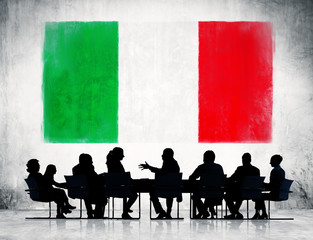Silhouette of Business People and Italian Flag