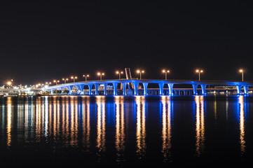 Blue illuminated bridge in Miami, Florida, USA