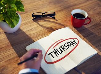 "Businessman Writing the Word ""Thursday"""