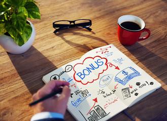 Businessman Sketching About Bonus Concepts