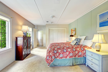 Bright simple bedroom with colofrul bed