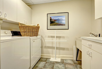 Simple laundry room with old washer and dryer