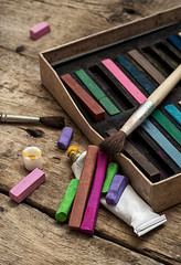 set of crayons and paints for painting