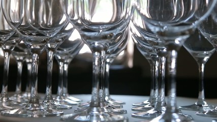 Lots of empty wine glasses. Close up. Dolly shot.