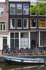 Traditional Dutch houses along the canal. (Amsterdam)