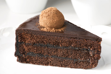 Slice of chocolate layer cake which truffle.