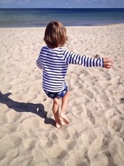 dancing child at the beach