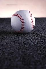 Softball on a gray mat