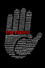 Hand with Stop Corruption text in indonesia languange