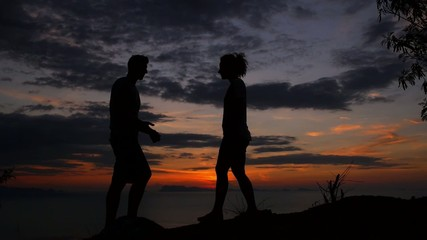 Silhouette Couple Embracing at Sunset. Slow Motion.