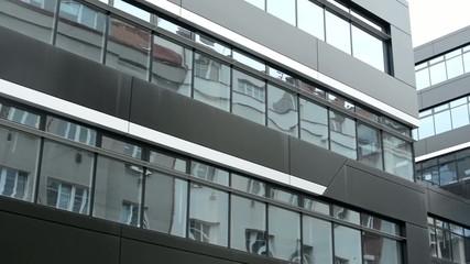 modern building - offices - windows - moderate rain