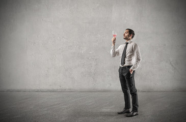 Businessman holding a glass